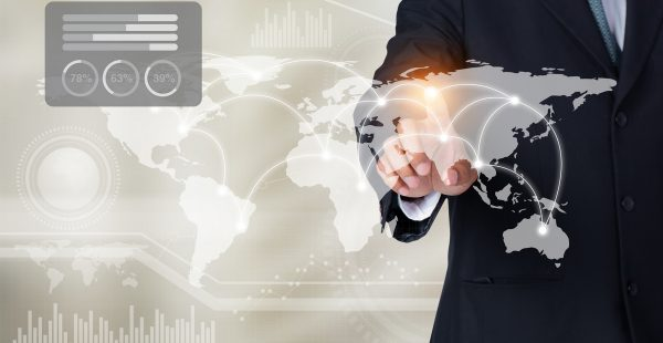 Businessman touching world map and graph on screen with his finger, Elements of this image furnished by NASA